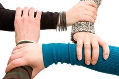 Quattro mani unite insieme Fotografia Stock Libera da Diritti