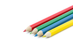Quattro matite variopinte su una fila Immagine Stock Libera da Diritti
