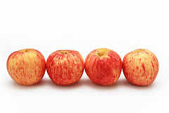 Quattro mele rosse con il fondo bianco dell'isolato Fotografia Stock Libera da Diritti