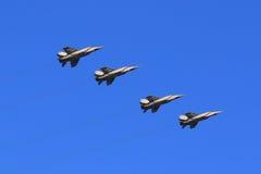 Quattro MiG-31BM in volo sul cielo blu del fondo Immagine Stock Libera da Diritti
