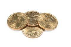 Quattro monete dorate Immagini Stock