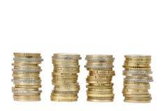 Quattro mucchi dei soldi della moneta (isolati) Fotografia Stock Libera da Diritti
