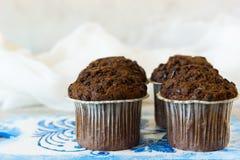 Quattro muffin del cioccolato Immagine Stock Libera da Diritti