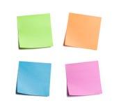 Quattro note appiccicose luminose fotografia stock