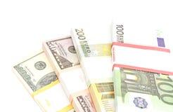 Quattro pacchetti dei dollari e delle banconote degli euro Fotografia Stock Libera da Diritti