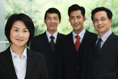 Quattro persone di affari cinesi Fotografia Stock
