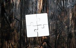 Quattro pezzi collegati di puzzle Immagini Stock