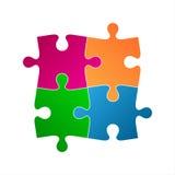Quattro pezzi colorati di puzzle, icona di simbolo astratto Fotografia Stock