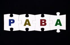 Quattro pezzi di puzzle con le lettere PABA Immagine Stock