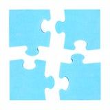 Quattro pezzi di puzzle hanno combinato il concetto della cooperazione Fotografia Stock Libera da Diritti