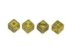 Quattro piccoli vecchi fatti a mano gialli tagliano in una fila Fotografia Stock