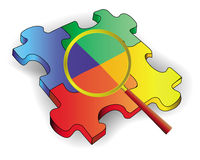 Quattro puzzle di colore con un obiettivo Immagini Stock Libere da Diritti