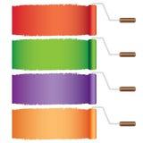 Quattro rulli con vernice. Fotografia Stock