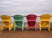 Quattro sedie del adirondack Fotografie Stock Libere da Diritti