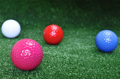 Quattro sfere di golf Immagine Stock