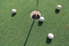 Quattro sfere di golf Fotografia Stock Libera da Diritti