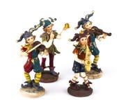 Quattro statuette dei musicisti di travestimento Fotografia Stock