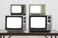 Quattro televisioni d'annata con gli schermi tagliati Fotografia Stock