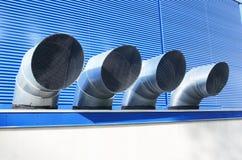 Quattro tubi di ventilazione di fabbricato industriale Immagine Stock