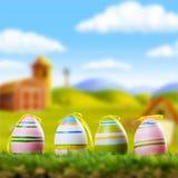 Quattro uova di Pasqua nell'erba Fotografia Stock Libera da Diritti
