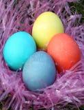 Quattro uova di Pasqua Variopinte Fotografie Stock Libere da Diritti