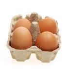 Quattro uova in una casella di carta Immagini Stock Libere da Diritti