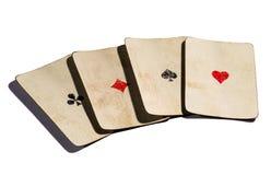 Quattro vecchie carte degli assi Immagini Stock