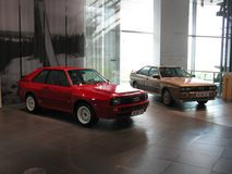 Quattros. Ingolstadt, Audi museum. A pair of Audi quattro, a grey one original Ur Quattro, and the wildest version, ared Sport Quattro show the different Royalty Free Stock Photography