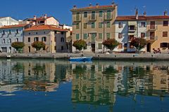 At the quay. Houses and theirs reflections at the quay in a small Italian town royalty free stock photos
