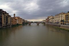 Quay of the Arno River in Florence. View of the Arno River in the Italian city of Florence. Overcast. Front view from the bridge bridge. View of the arch bridge stock photo