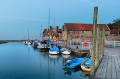 The Quay at Blakeney in Norfolk. Boats on the quay at Blakeney on the north coast of Norfolk royalty free stock image