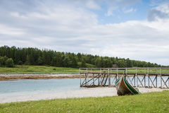 A quay and a boat in Northern Norway during lowtide Stock Photography