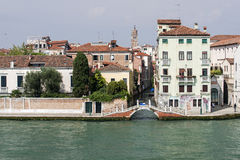 Quay and bridge over small channel in Venice Royalty Free Stock Photos