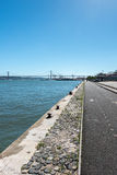 Quay with bridge over Tagus river in background, Lisbon (Portuga Stock Image