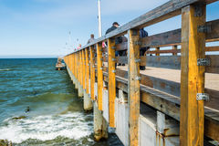 Quay bridge pier by the sea. Wooden bridge, pier, moorage, on the embankment of the Baltic Sea Royalty Free Stock Image