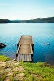 Quay on a calm lake Stock Photo