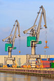 Quay Cranes. Container terminal scene in the Port of Rotterdam against Royalty Free Stock Photography