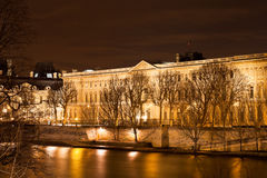 Quai du louvre in Paris at night Royalty Free Stock Photo
