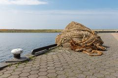 Quay with fishing nets at harbor of Urk, the Netherlands Stock Photography