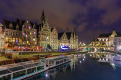 Quay Graslei in Ghent town at evening, Belgium. Ghent, Belgium - December 29, 2014: Picturesque medieval building on the quay Graslei in Leie river at evening stock images