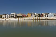 Embankment of Guadalquivir river with Triana district, Seville. Quay of Guadalquivir river with colorful traditional houses of Triana district, Seville royalty free stock photography