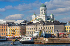 Quay of Helsinki with moored ships and main city Cathedral Stock Images