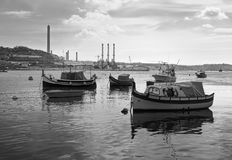 Quay of the Maltese city of Marsaxlokk. Black and white. Quay of the Maltese city of Marsaxlokk. Ludza boats. The beauty of the old Maltese. Black and white Royalty Free Stock Photo