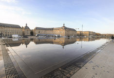 The Quay Mirror. BORDEAUX, FRANCE - DECEMBER 22, 2011:  The Quay Mirror in front of the Place Royale (Place de la Bourse).  This water mirror covers a 3450 m2 Stock Images