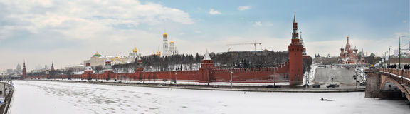 Quay of Moscow-river. The Kremlin costs on coast of the river Moscow Royalty Free Stock Photo