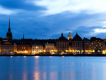 Quay night in Stockholm. Sweden. Quay night in Stockholm. Stockholm. Sweden. 03.08.2016. Skeppsholmen bridge laid across the Strait of Riddarfjärden and stock image