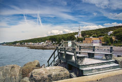 Quay. In Notre Dame du Portage Quebec, Canada. View of the Village and the Saint Lawrence Seaway stock image