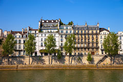 Quay of Paris. Famous quay of river Seine in Paris with buildings and trees Royalty Free Stock Photography