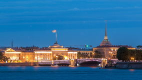 Quay of river Neva with building of Admiralty and Palace bridge timelapse at wthite night. St. Petersburg, Russia. Quay of river Neva with illuminated building stock video footage