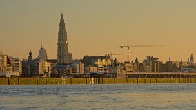 Quay of river Scheldt in Antwerp in warm sunset light royalty free stock images